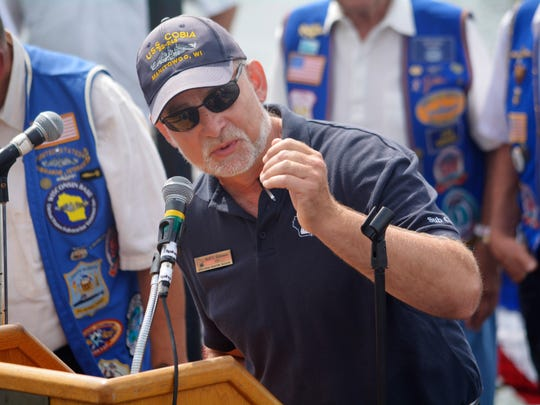 Rolf Johnson, CEO of the Wisconsin Maritime Museum, gives the closing remarks on the USS Cobia on Sunday in Manitowoc. Johnson's remarks concluded a service to honor veterans who served on submarines throughout U.S. military history.