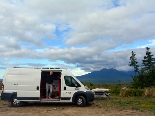 """Mikah Meyer and """"Vanny McVanface"""" (as he calls the cargo van he converted into a mobile home) in September in Maine's Katahdin Woods and Waters National Monument, America's newest National Park Service site."""