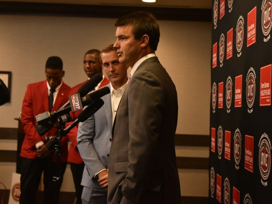 Austin Peay football coach Will Healy speaks with members