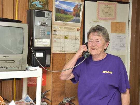 Scotties owner Willette Tillman uses the restaurant pay phone.