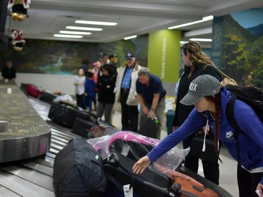 Passengers on Delta flight 2263 from Atlanta pick up