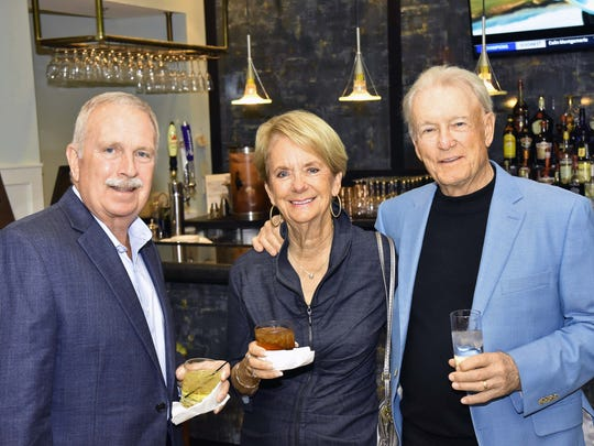 Jack Reis, left, with Betsy and Tom Otteson.