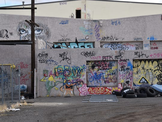 A photo showing a wall filled with graffiti at a property on Dermody Way in Sparks. The property was believed to have been abandoned and has been marked with graffiti and used as a garbage dumping ground.