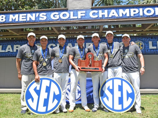 Auburn men's golf team poses for a photo after winning