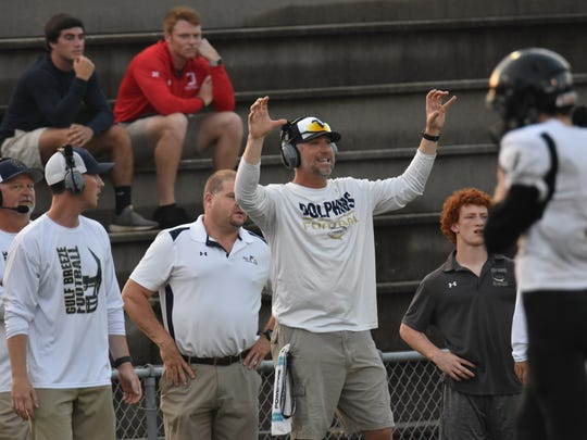 Gulf Breeze coach Bobby Clayton yells instructions in Friday's spring game against Milton.