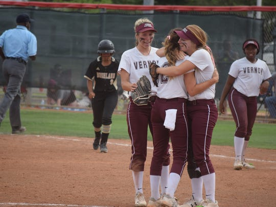 Vernon pitcher Jade Guzman is embraced by teammates