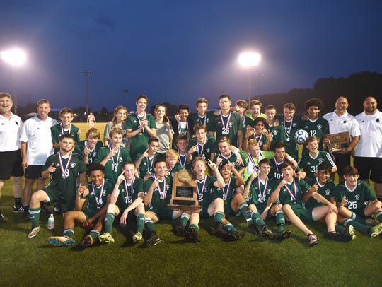 Greeneville celebrates its Class AA soccer championship.