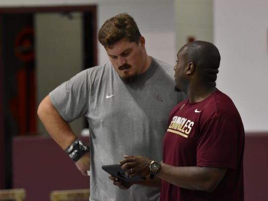 Austin Droogsma, left and FSU assistant track coach
