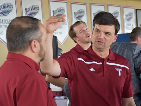 Troy Trojans football coach Neal Brown meets with area