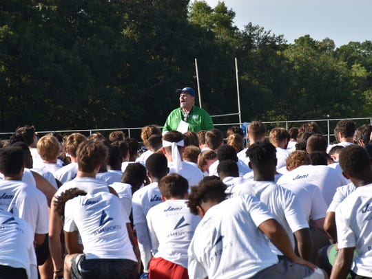 UWF football coach Pete Shinnick addresses a group of more than 300 players who attended the July 13 UWF football camp at Pen-Air Field