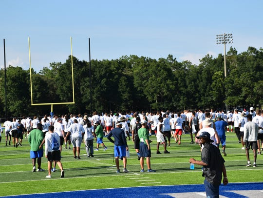 he mass of players get ready on July 13 to begin UWF's football camp at Pen-Air Field.