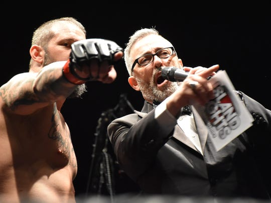 Shannon Edmondsen,left, points out his cheering section in a post-fight interview with ring announcer Christopher J. Rothstein during Saturday's Island Fights 49 event at the Bay Center.