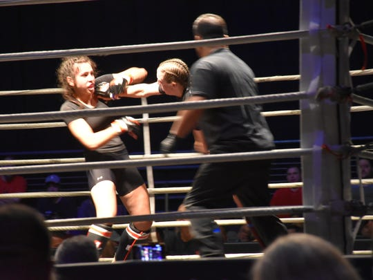 Ashley Averitt lands a punch against Griffin Fisk early into their MMA women's batamweight bout that Fisk would win in second round during Island Fights 49 at the Bay Center.