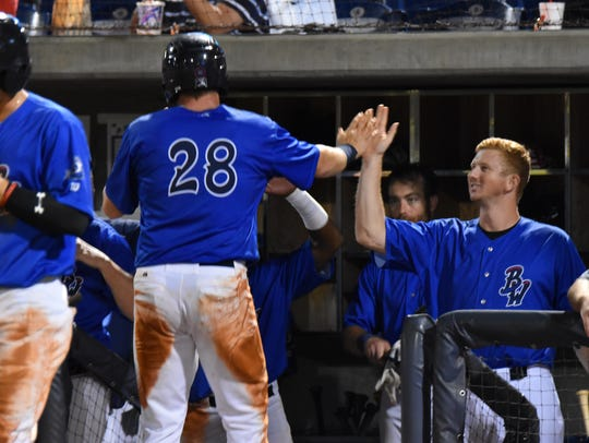 The Blue Wahoos Mitch Nay (28) is congratulated by