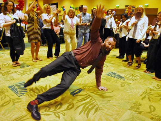 Patrick Farley, a teacher at Crystal Lake Elementary School and last year's Martin County Teacher of the Year, shows off his dance moves at the Teacher of the Year banquet in November 2017.