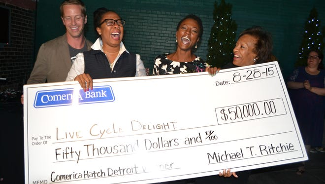 The winners of the 2015 Hatch Detroit Contest hold their $50,000 check at the final Hatch Off event at the M@dison Building in downtown Detroit on Friday, Aug. 28. Nick Gorga, founder of Hatch Detroit, from left, Jackie Palmer and Amina Daniels of Live Cycle Delight, and Linda Forte, chief diversity officer at Comerica Bank.