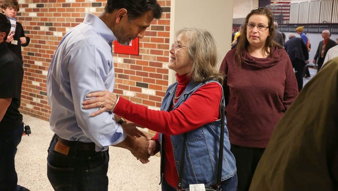 Louisiana Gov. Bobby Jindal, a Republican candidate for president of the United States, is greeted by a supporter after speaking on Friday, Oct. 23, 2015, at Faith Baptist College in Ankeny, Iowa.