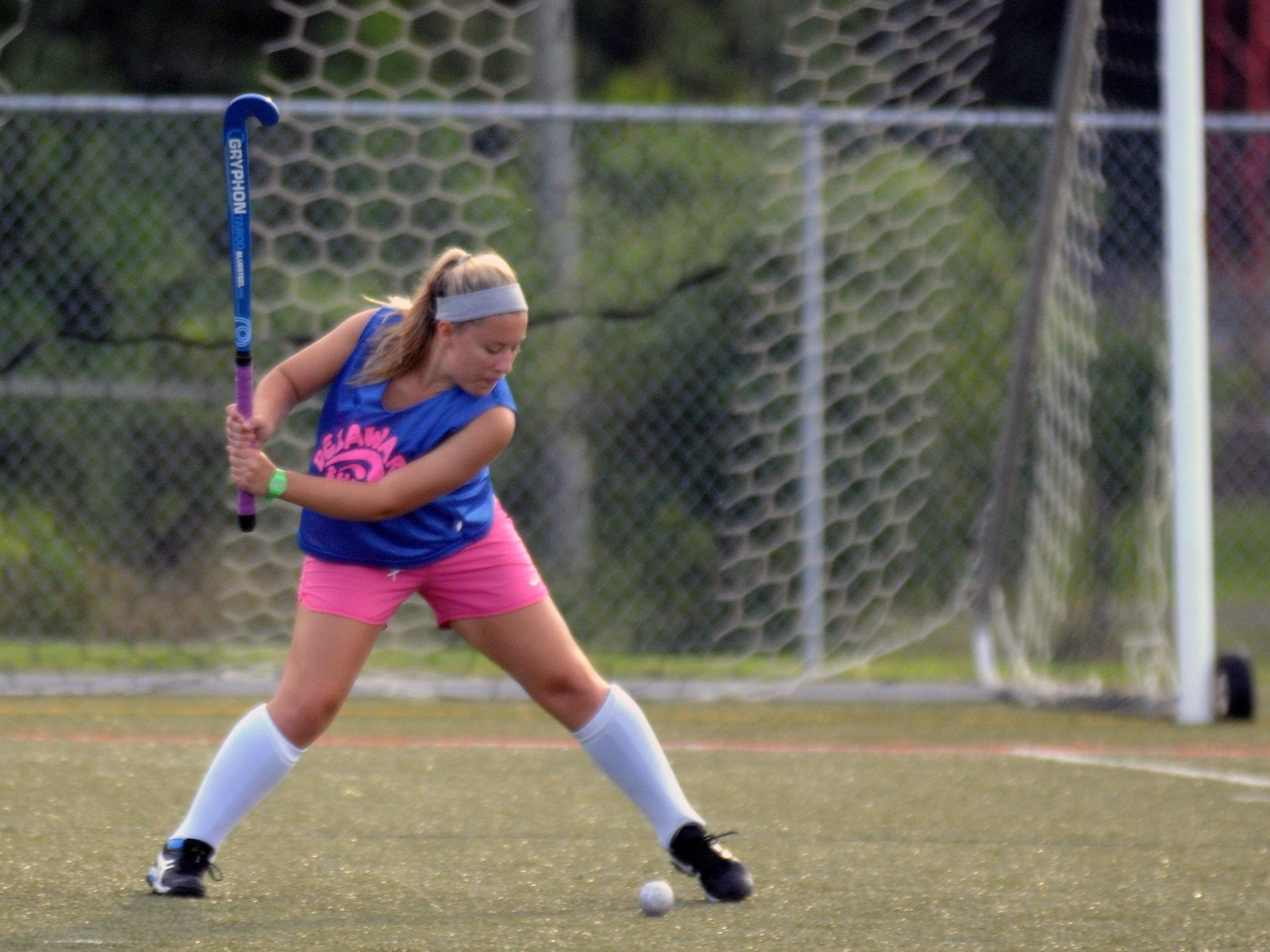A Delaware Shore Field Hockey player takes a shot during a summer league game at Cape Henlopen High School. Some of these players will be traveling with the U14 team to Disney World.