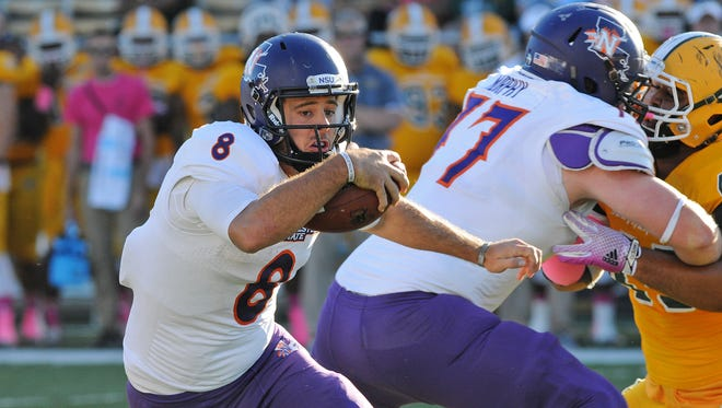 Northwestern State quarterback Zach Adkins (8) runs the ball against Southeastern Louisiana on Saturday. Adkins ran for a TD and threw for another, but he was intercepted four times in the Demons' 30-22 loss to to the Lions.