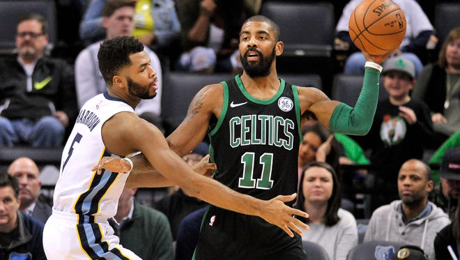 Boston Celtics guard Kyrie Irving (11) controls the ball against Memphis Grizzlies guard Andrew Harrison (5) in the first half of an NBA basketball game Saturday, Dec. 16, 2017, in Memphis, Tenn. (AP Photo/Brandon Dill)