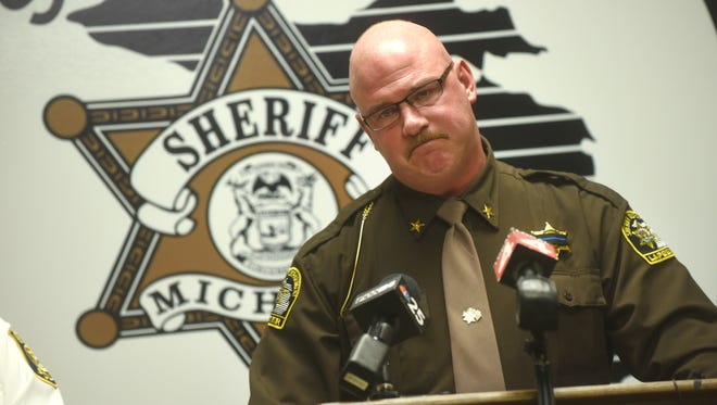 Lapeer County Sheriff Scott McKenna get emotional as he speaks on November 24, 2017  about the death of Oakland County Sheriff's deputy Eric Overall during a news conference in Lapeer.