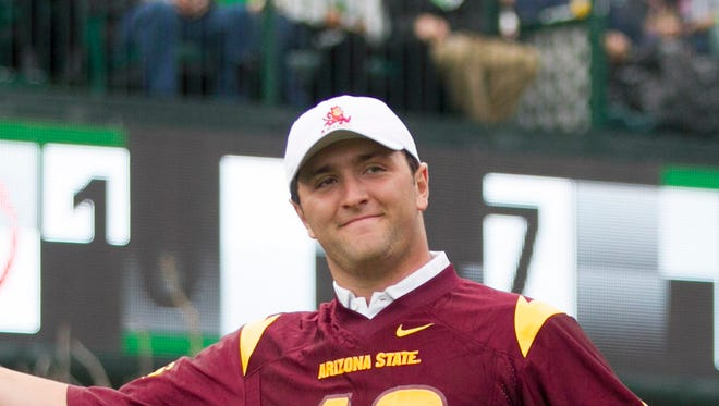 ASU's Jon Rahm tries to excite the crowd before teeing off on the 16th hole during the third round of the 2015 Waste Management Phoenix Open at TPC Scottsdale.