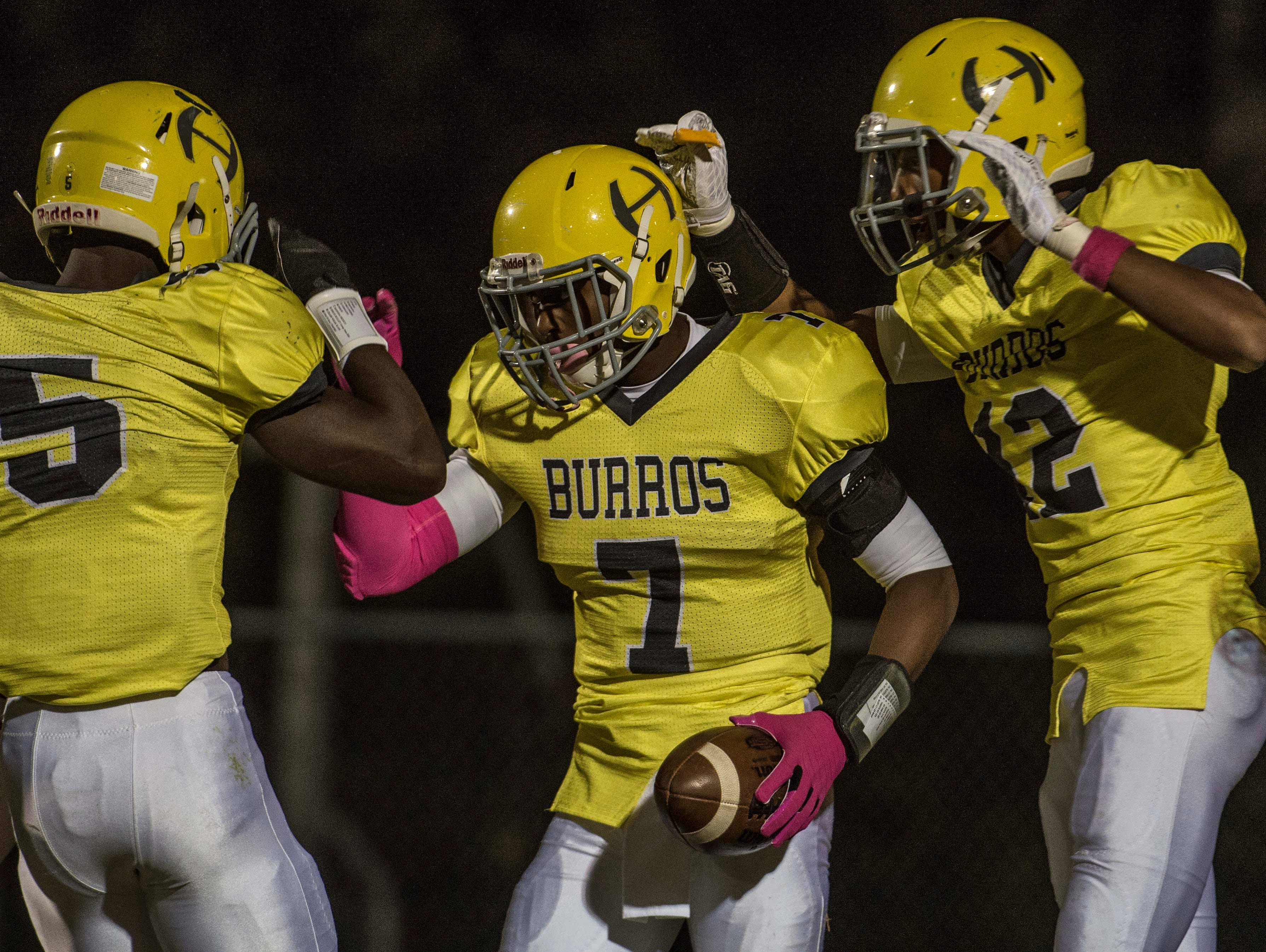 Hillsboro's Jeremy Hill is congratulated after scoring a touchdown against Hunters Lane.