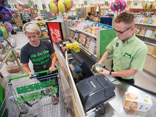 Instacart shopper Kara White checks out with a customer's