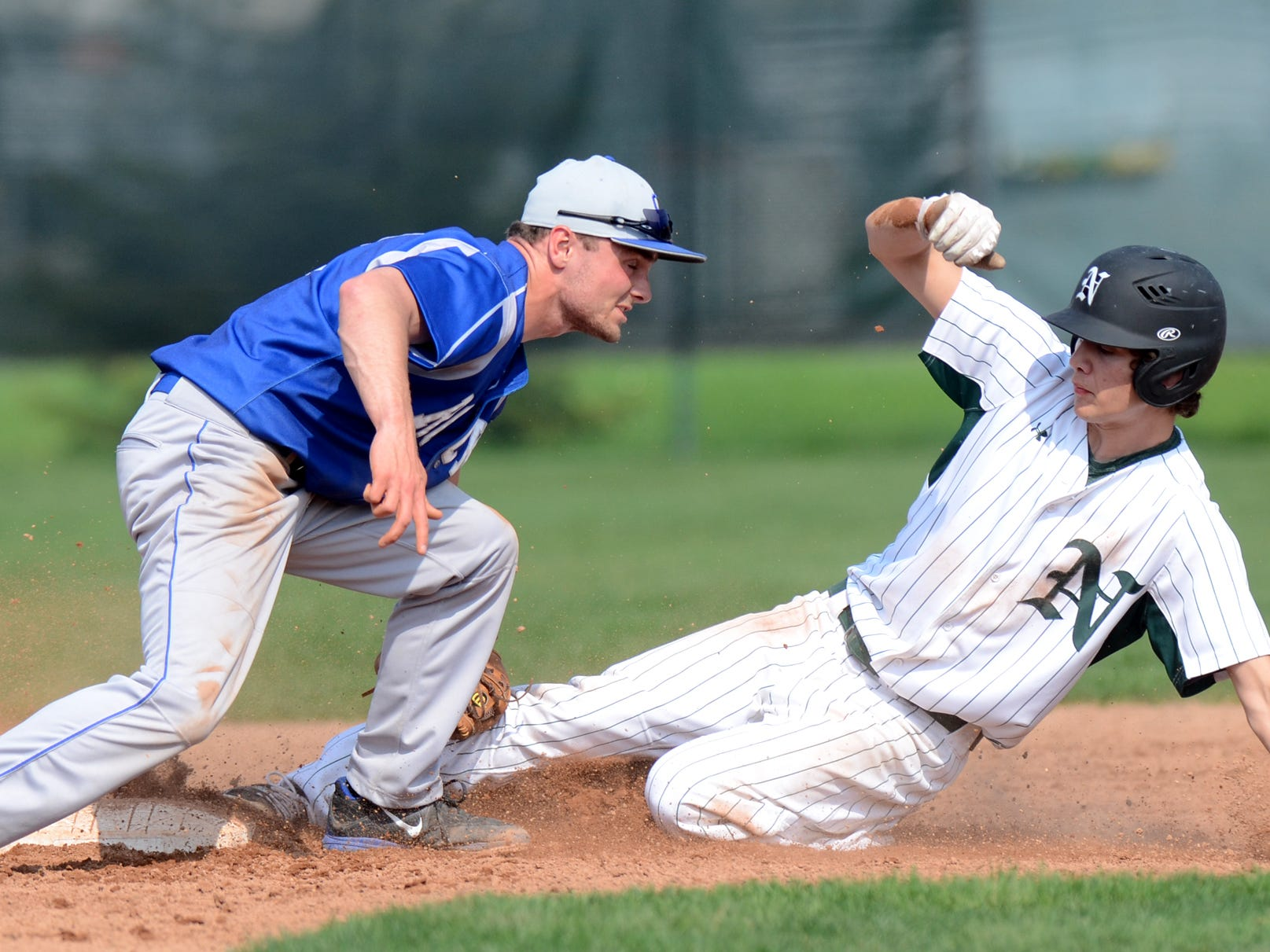 Novi's Alex Bageris slides into second base but not before Salem shortstop Josh Penn applies a tag during Wednesday's KLAA Central Division doubleheader.