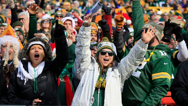 Packers fans celebrate a touchdown in the first quarter of a Dec. 24, 2016, game against the Vikings.