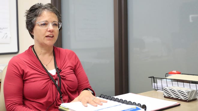Washington Middle School principal Cindy Olson speaks to the Press-Gazette in her office.