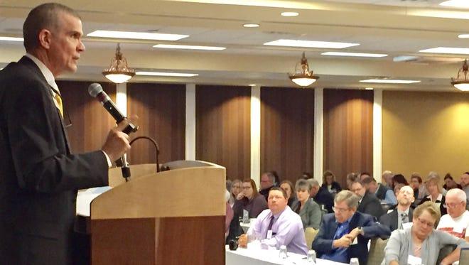 State Insurance Commissioner Matt Rosendale addresses an insurance summit Wednesday in Helena.