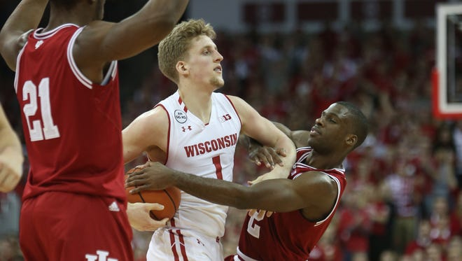 Badgers guard Brevin Pritzl is doubled by Indiana Hoosiers forward Freddie McSwain and guard Josh Newkirk.
