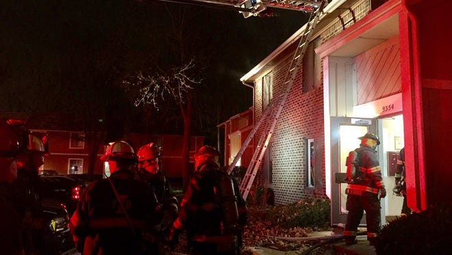 Firefighters responded to a fire Friday morning at Woodbridge Apartments on the city's northeast side.