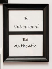 "The framed inspirational words of ""Be Intentional."