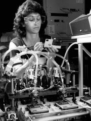 An Eastman Kodak Co. employee tests shutter and flash synchronization on a disc camera in this 1982 photo.