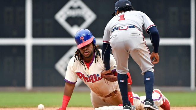 Apr 29, 2018; Philadelphia, PA, USA; Philadelphia Phillies third baseman Maikel Franco (7) slides safely into second base on an error during the fourth inning against the Atlanta Braves at Citizens Bank Park. Mandatory Credit: Eric Hartline-USA TODAY Sports