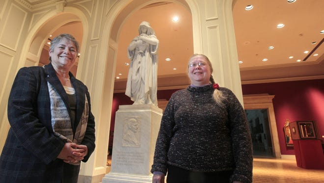 Retired Memorial Art Gallery curator Marjorie Searl, left, and MAG librarian Lu Harper pose together in the Watson Family Foyer at the Rochester museum. The pair created a timeline on Emily Sibley Watson. The marble statue behind them, Memory, 1914, by artist William Ordway Partridge, was commissioned by Sibley Watson as a tribute to her son, James G. Averell, who died in 1904.