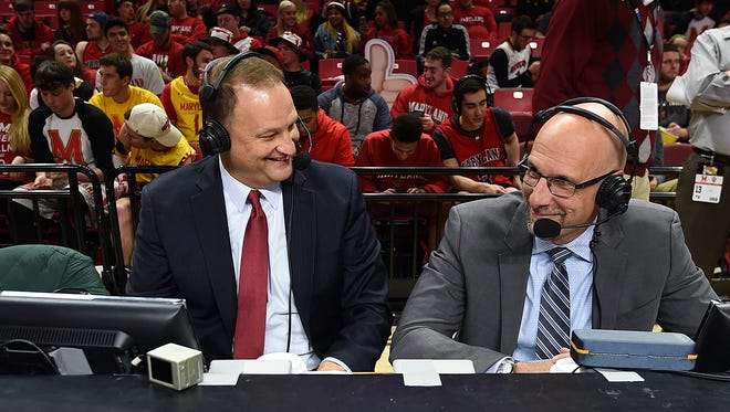 ESPN analysts Dan Dakich, left, and Dan Shulman await the start of the Maryland and Indiana NCAA college basketball game, Tuesday, Jan. 10, 2017 in College Park, Md. (AP Photo/Gail Burton)