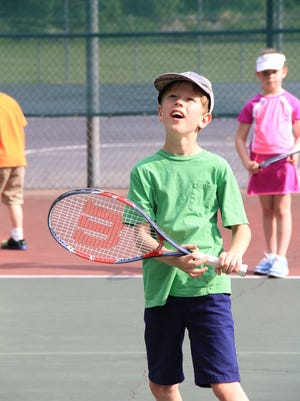 Asheville has many public courts where kids can practice tennis skills.