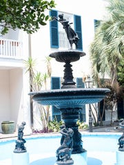 An imported fountain add to the serene beauty of the