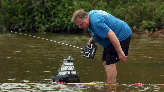 Walter Pommnitz of Clark launches his boat the Exxon Empire State during the annual Regatta on Budd Lake in Mount Olive. July 26, 2014, Mt Olive, NJ. Photo by Bob Karp