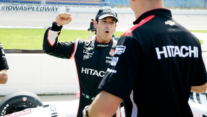 Helio Castroneves reacts after winning the pole position in the IndyCar Series auto race Saturday, July 18, 2015, at Iowa Speedway in Newton, Iowa.