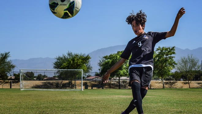 Damian Vasquez, 15, is pursuing his dream to become a professional soccer player. Damian is photographed at Las Flores Park in Coachella on Friday, July 15, 2016.