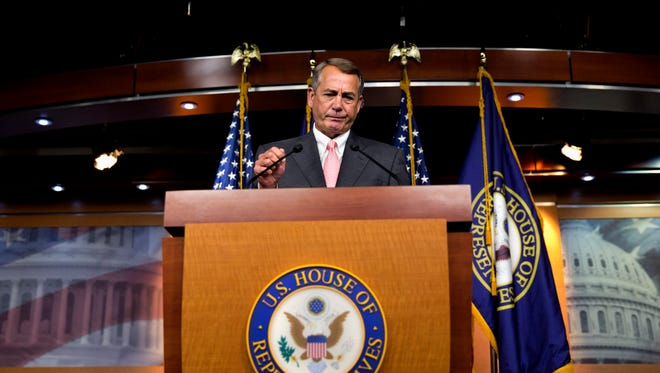 House Speaker John Boehner of Ohio pauses during his news conference on Capitol Hill on Sept. 25, 2015.