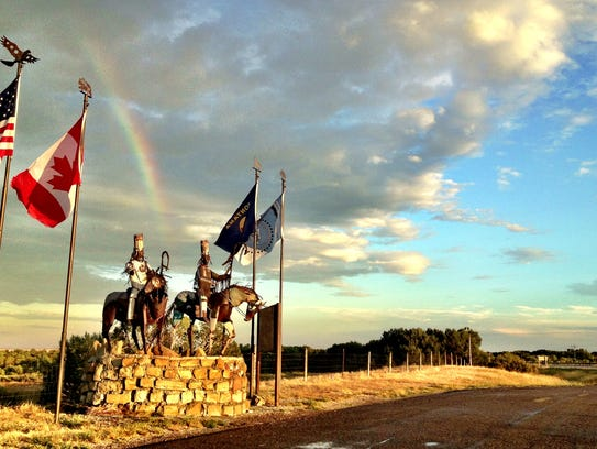 A rainbow above the entry onto the Blackfeet Reservation