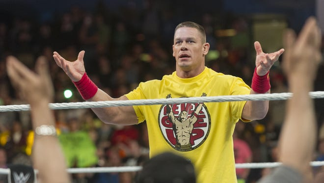 John Cena gets the crowd fired up before the big match of the evening. WWE Monday Night Raw came to Banker's Life Fieldhouse, Monday, Nov. 24, 2014, where wrestling superstars John Cena, Seth Rollins, Dean Ambrose, Kane, Triple H, and Bray Wyatt, battled in the ring. Monday Night Raw claims to be the longest-running, weekly episodic program in U.S. primetime TV history.
