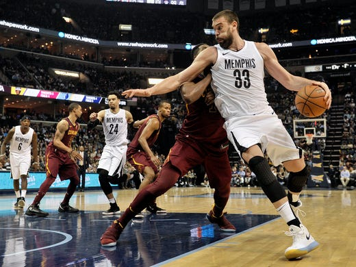 Memphis Grizzlies center Marc Gasol (33) drives against against Cleveland Cavaliers center Tristan Thompson during the second half of an NBA basketball game Friday, Feb. 23, 2018, in Memphis, Tenn. (AP Photo/Brandon Dill)