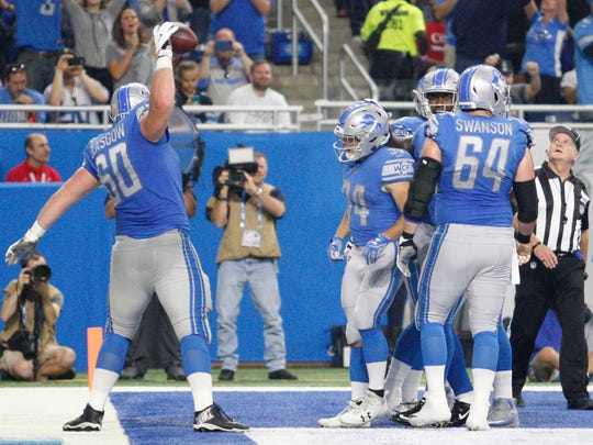 Detroit Lions offensive guard Graham Glasgow (60) spikes