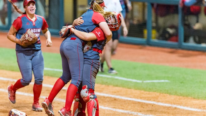 UL catcher Lexie Comeaux and pitcher Summer Ellyson celebrate advancing to the Baton Rouge Regional finals with two wins on Saturday.